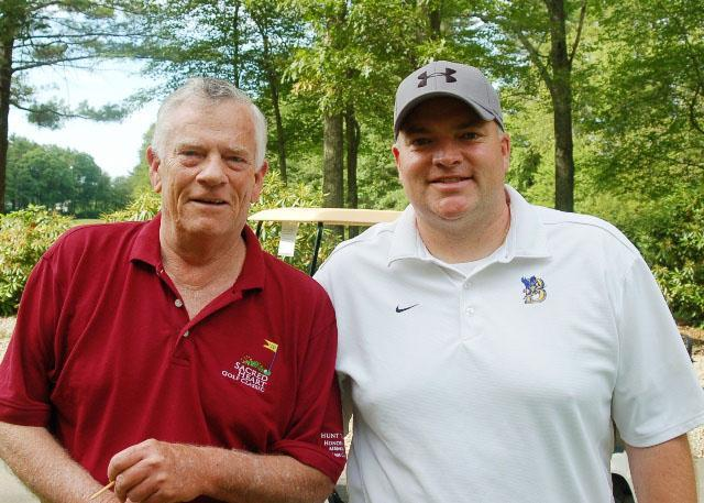 Larry Hunt (left) and son Dan at last year's golf tournament honoring William C. Hunt.