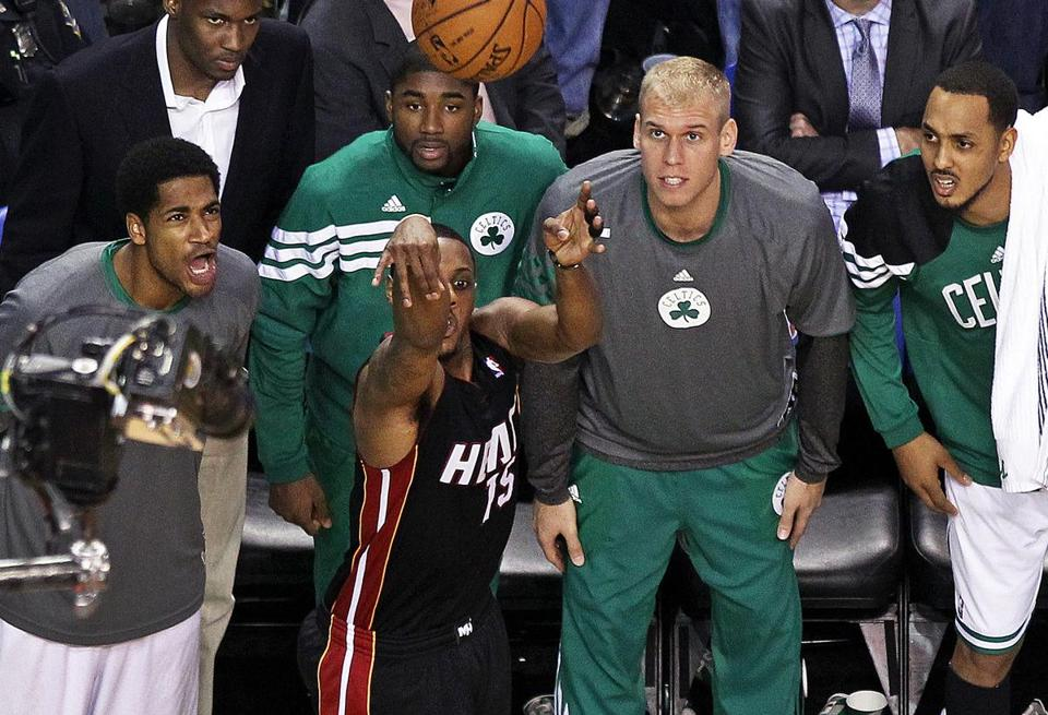 Mario Chalmers misses a 3-pointer late in Game 4  - perhaps with some help from the Celtics bench.