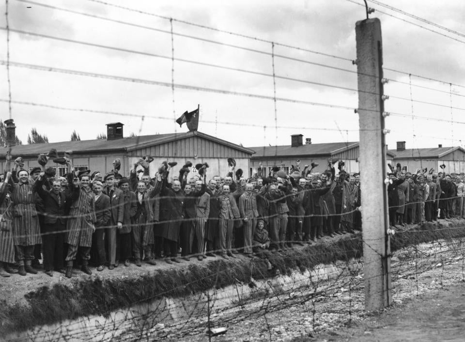 Prisoners at Dachau cheer US troops who liberated the concentration camp in May 1945.