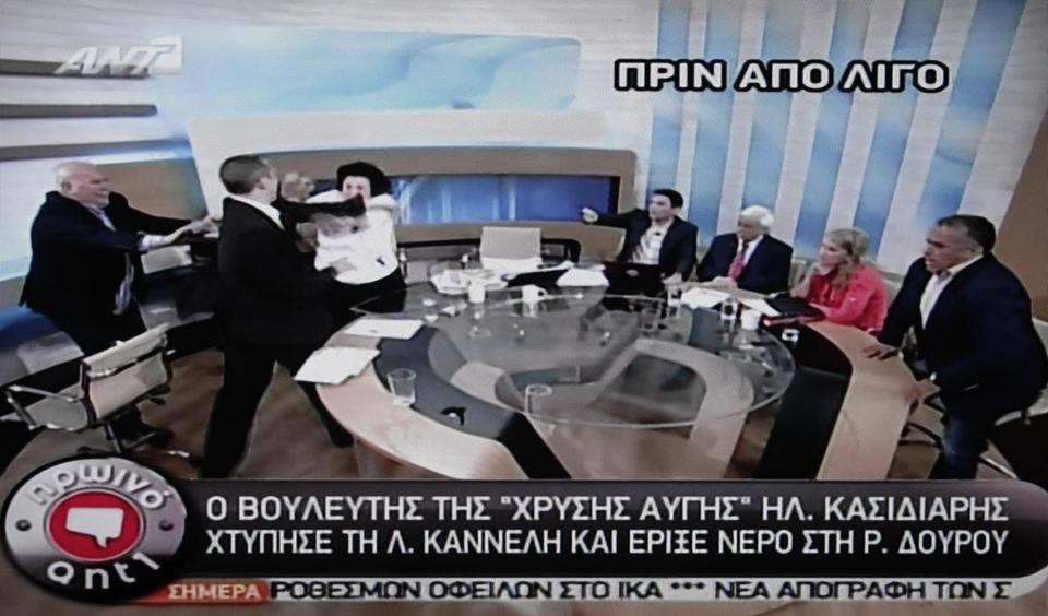 An image from video shows a far-right member of Greece's Parliament attacking Liana Kanelli, also a Greek lawmaker and a Communist Party member, during a televised talk show. The outburst came a little more than a week before general elections in Greece that could determine the nation's future in the eurozone.