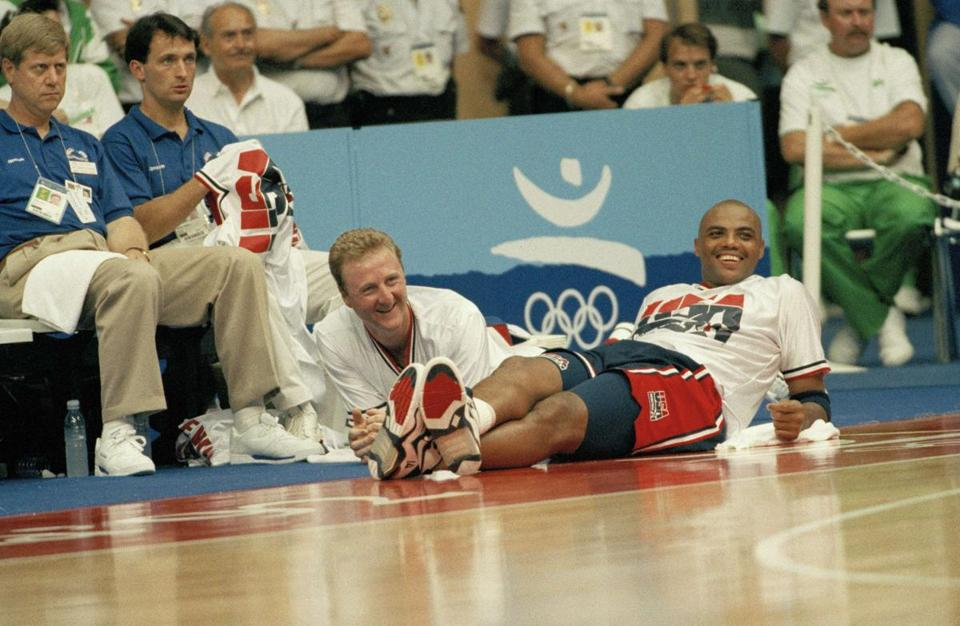 During the Dream Team's 127-83 win over Brazil in the 1992 Summer Olympics, Larry Bird, left, and Charles Barkley were able to relax on the sidelines.