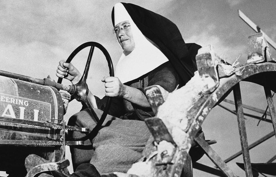 Sister Mary Othelia operates a tractor at the Mount Asissi Convent in Illinois in 1942. The nuns did all of the planting and harvesting on the 100-acre farm.
