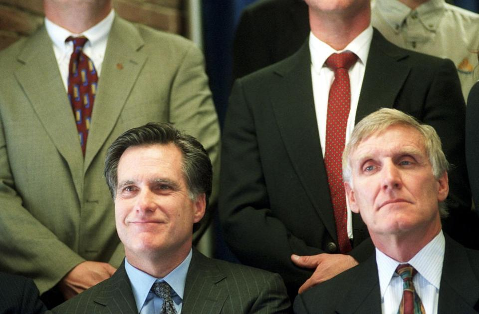Massachusetts Governor Mitt Romney and Chief of Commonweath Development Doug Foy attend a press conference in 2003, where Romney announced a plan to redirect the focus of the Renewable Energy Trust.