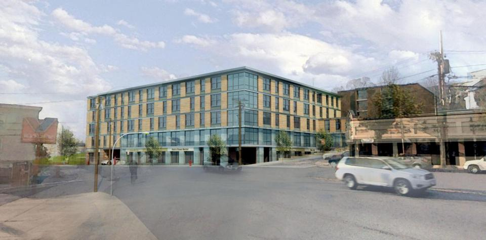 A rendering of the 40-unit building of affordable housing that the Somerville Community Corporation has proposed for 181 Washington St., the former Pope School. Some 200 people have signed a petition opposing the project.
