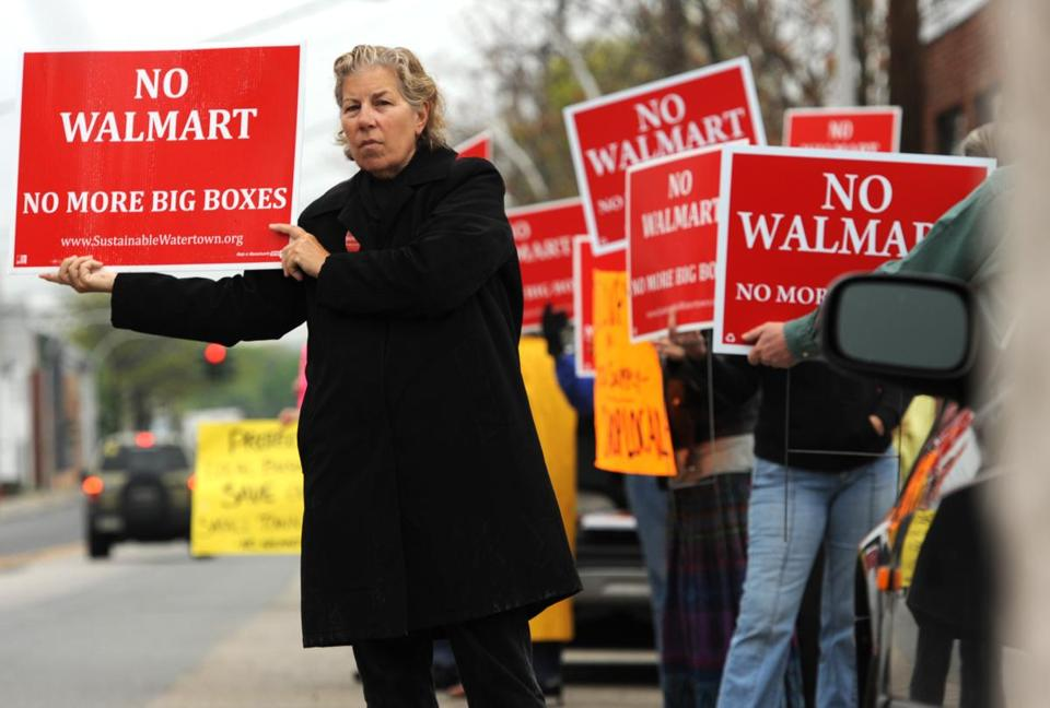 Protesters lined Arsenal Street in Watertown in early May to protest a proposed Walmart.