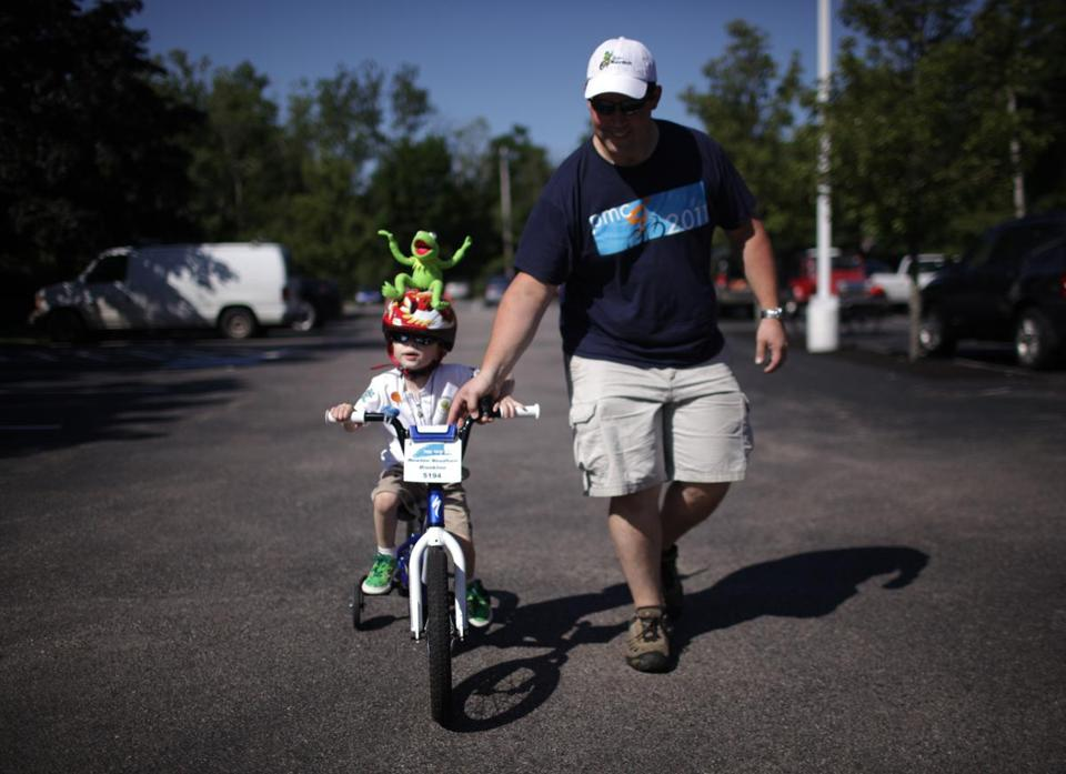 Chris Smith guides his 3-year-old son Jack through the Pan-Massachusetts Challenge kids course in Newton this past spring.