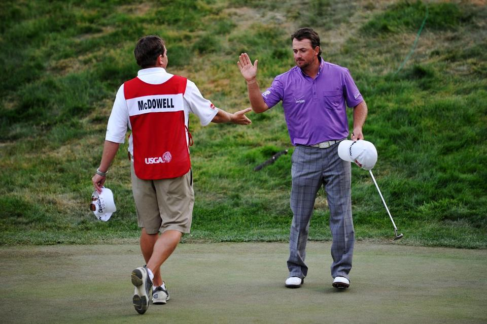 Graeme McDowell celebrates with caddie Ken Comboy after draining a 6-foot birdie putt on No. 18, giving him the lead at 1 under par, where he was joined minutes later by Jim Furyk.