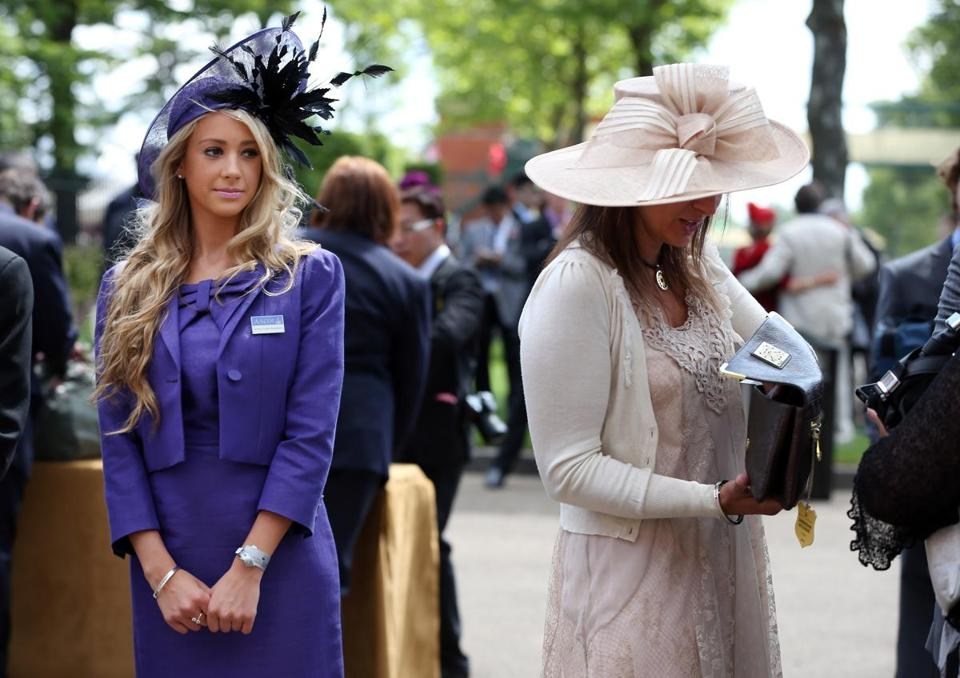 A Dress Code Assistant keeps a watchful eye at main entrance to Royal Ascot horse race in England.