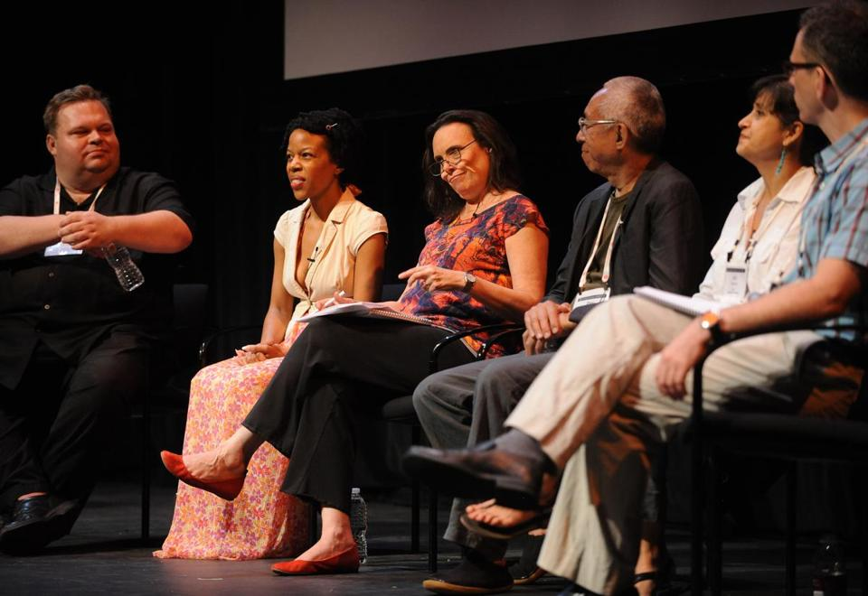 From left: At the Cutler Majestic Theatre, Mike Daisey, Nilaja Sun, Emily Mann, Ping Chong, KJ Sanchez, and Steve Cosson participated in a panel discussion as part of the Theatre Communications Group conference.
