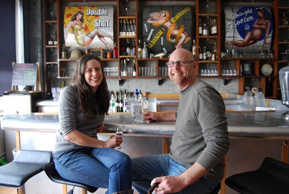 Ellie and Lance Winters in the pilot's lounge upstairs in the old hangar at St. George Spirits in Alameda, Calif.