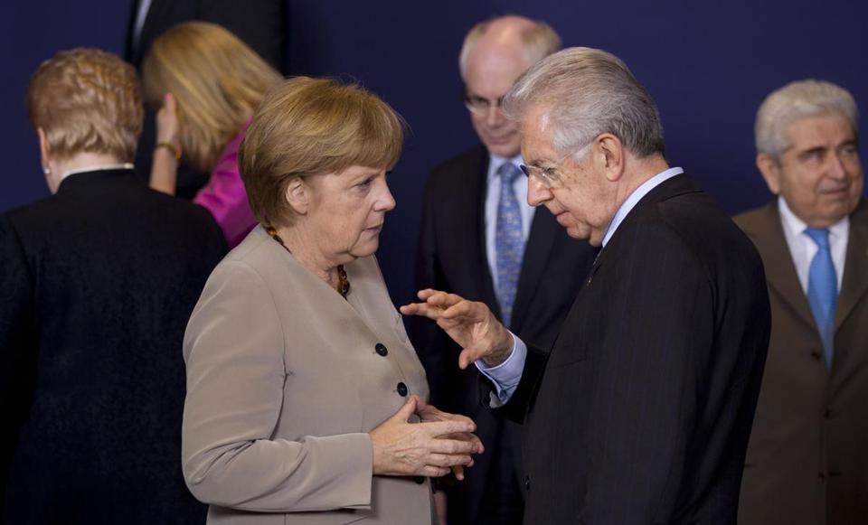 Chancellor Angela Merkel of Germany spoke with Prime Minister Mario Monti of Italy at the EU summit in Brussels on Thursday.