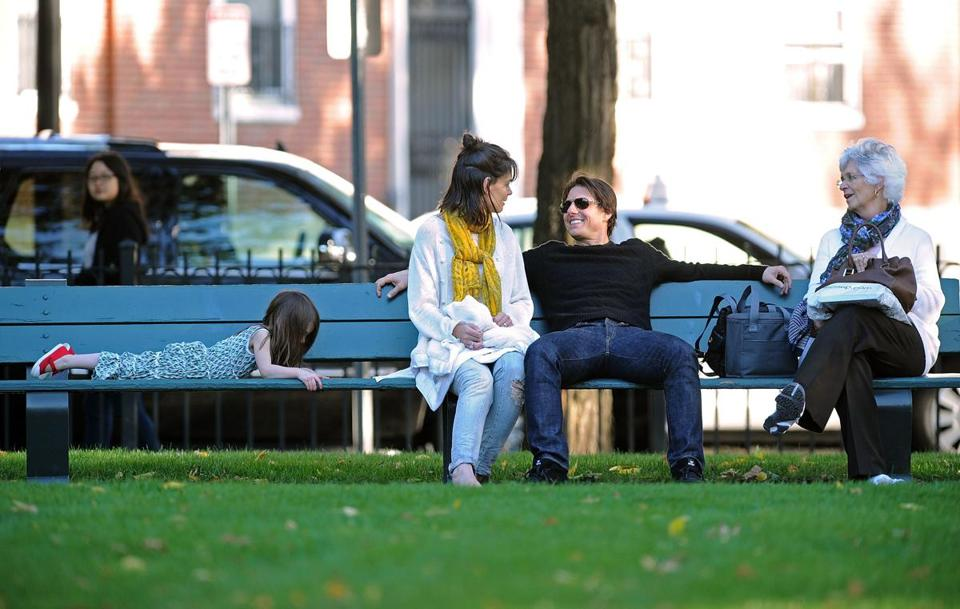 In 2009, Tom Cruise took a break from filming and sat by the Charles River with wife Katie Holmes, daughter Suri, and Holmes's mother, Kathy.