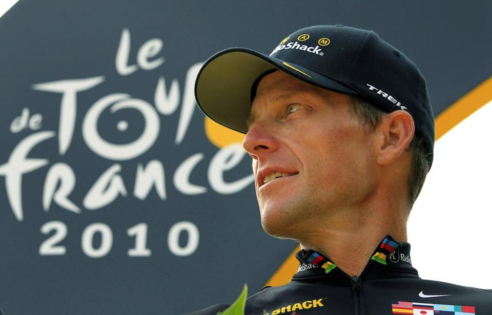 Lance Armstrong looked back on the podium after the last stage of the Tour de France in Paris in this July 25, 2010 file photo.