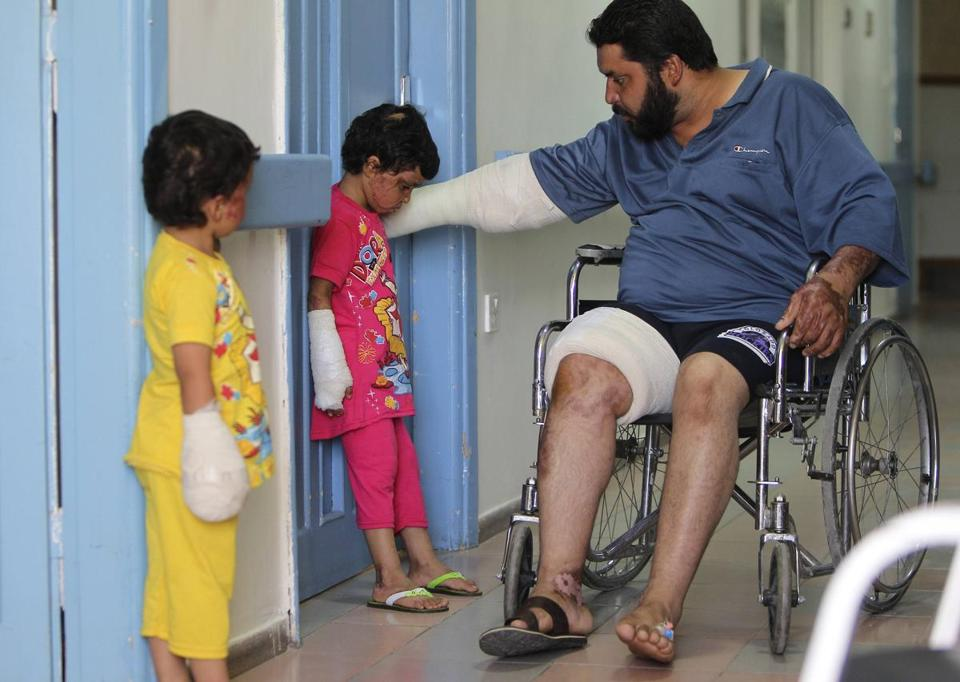 Syrian girls and their father recuperated at a hospital in Amman from violence suffered in their country.