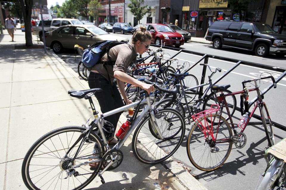 Ellen Kokinda removed her vehicle from the corral ­— one of the parking spaces Somerville has set aside for bicyclists.