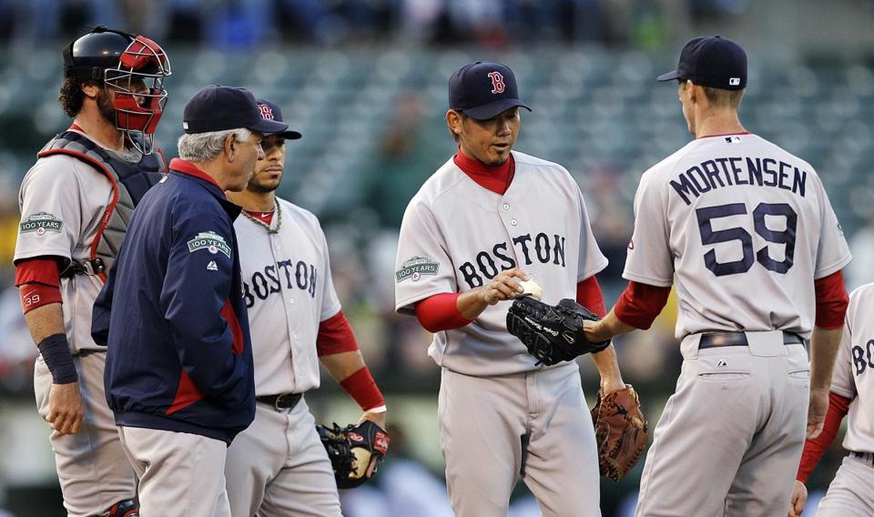 Daisuke Matsuzaka, center, was pulled from the game in the second inning Monday.