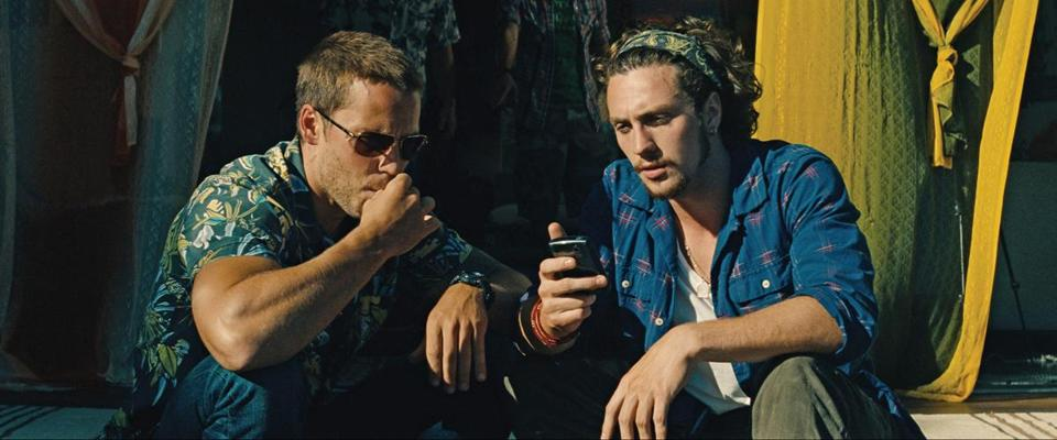 "Taylor Kitsch (left) and Aaron Johnson in Oliver Stone's ""Savages."""