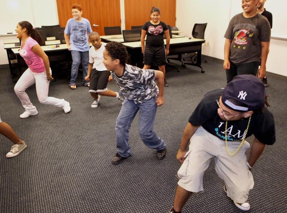 Fedner Dorrelus (far right) led a hip-hop class as part of Boston's Afterschool and Beyond program.