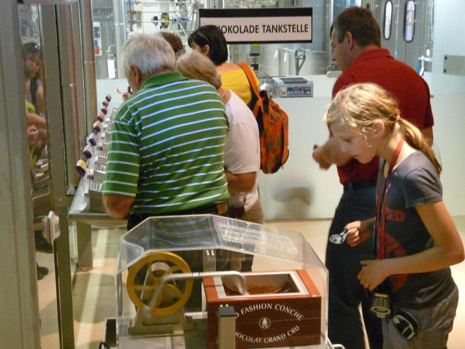 "On the tour of the Zotter Chocolate Factory, in Bergl, Austria, a girl watches ""chocolate grand cru"" being made."