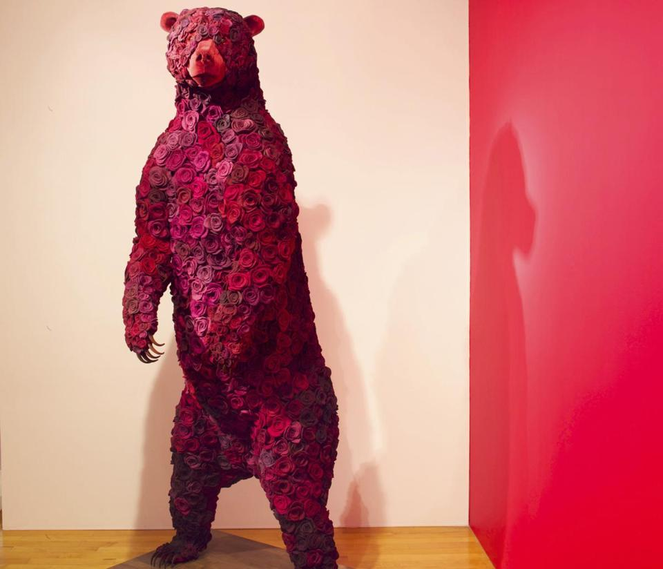 """Widow'' (2012) by Janice Wright Cheney. The 7-foot-10-inch-tall work is made of wool, cochineal dye, velvet, taxidermy form, pins, and wood."