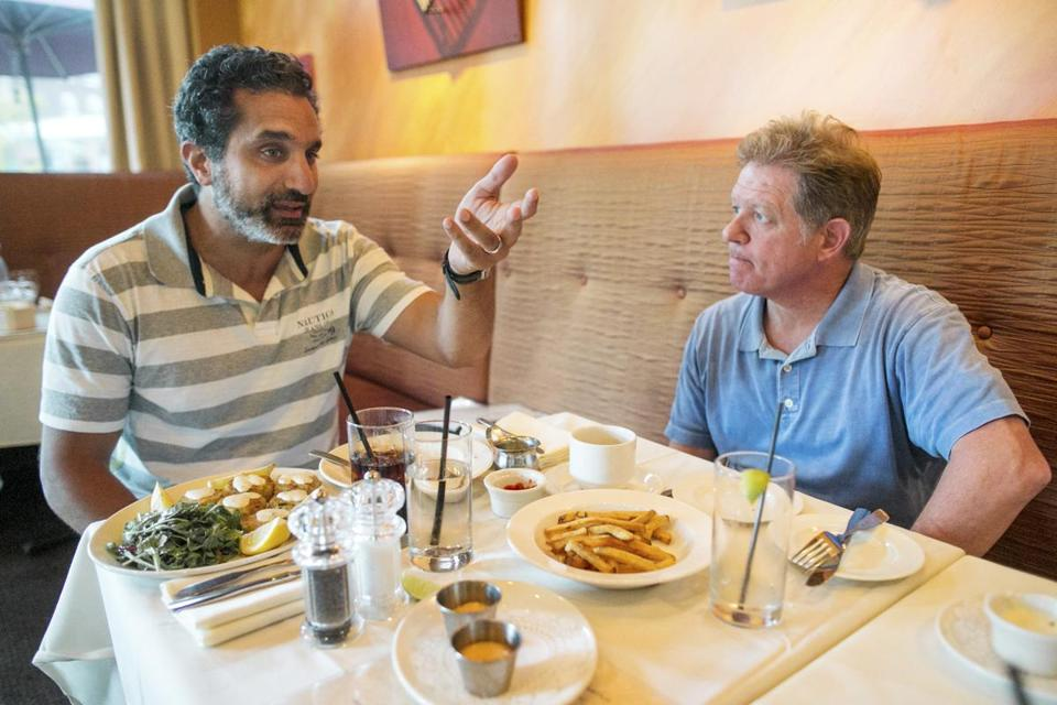 Egyptian comedian Bassem Youssef (left) ate lunch with political satirist Jimmy Tingle in Brookline. They talked extensively about Egyptian politics and the media.