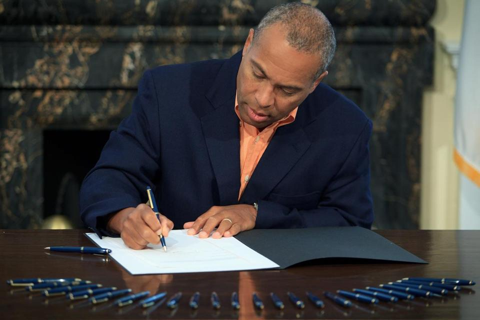 """The fiscal environment remains challenging,"" Governor Deval Patrick said Sunday. He also vetoed $32.1 million in spending."