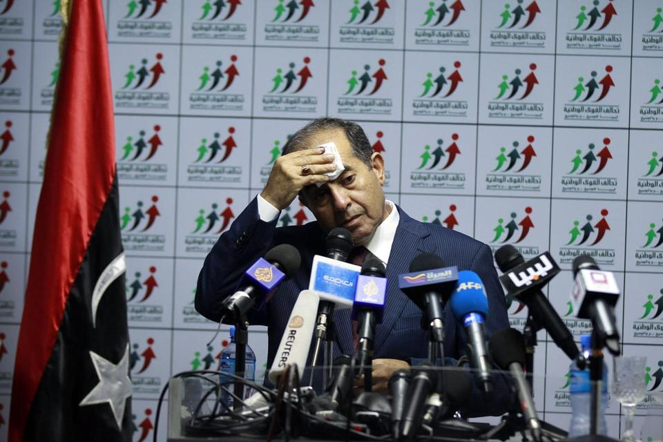 Mahmoud Jibril, head of the National Forces Alliance, wiped his brow during a news conference at his party's headquarters in Tripoli Sunday.