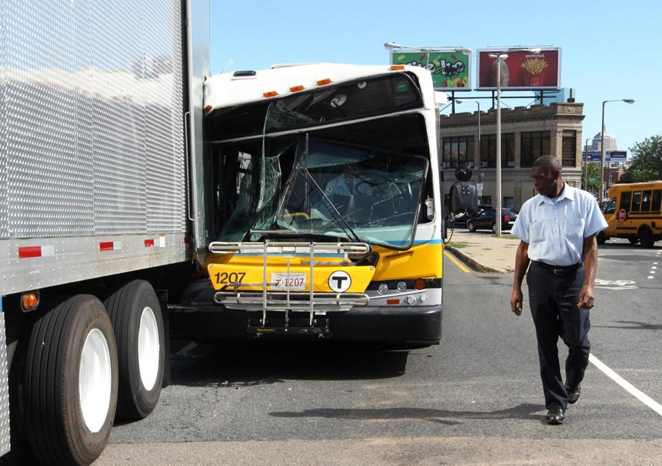 An MBTA bus collided with a movie production truck parked outside the Roxbury Municipal Court Monday. Fifteen people, including the bus driver, were being examined by emergency medical personnel.