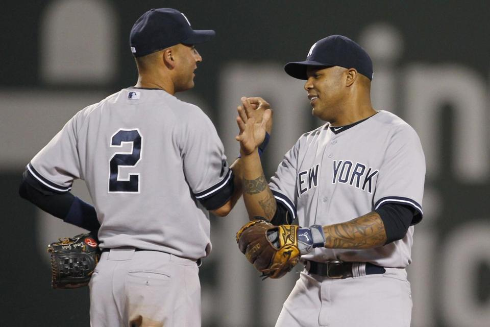 New York Yankees Derek Jeter and Andruw Jones celebrated their win over the Boston Red Sox at Fenway Park Sunday.