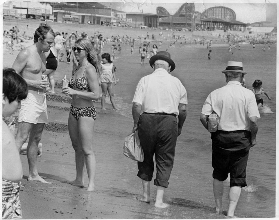 August 23, 1972: Revere Beach was a destination spot for many beachgoers and amusement park aficionados. Here, Mr. Peter Sousi and Mr. Michael Federico, both of Roslindale, were visiting for a stroll on the beach.