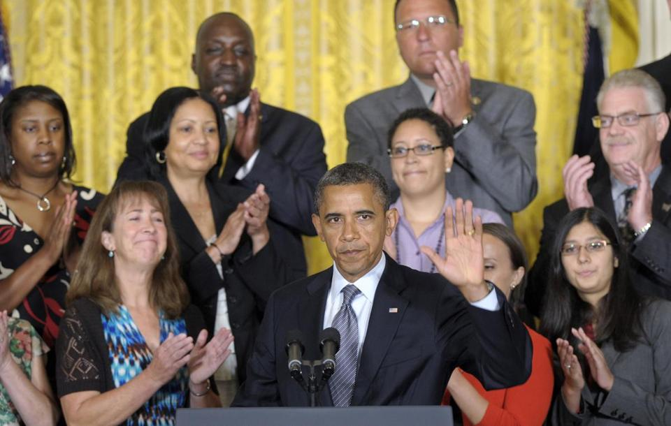 President Obama was flanked by middle-class families and small-business owners during his address.