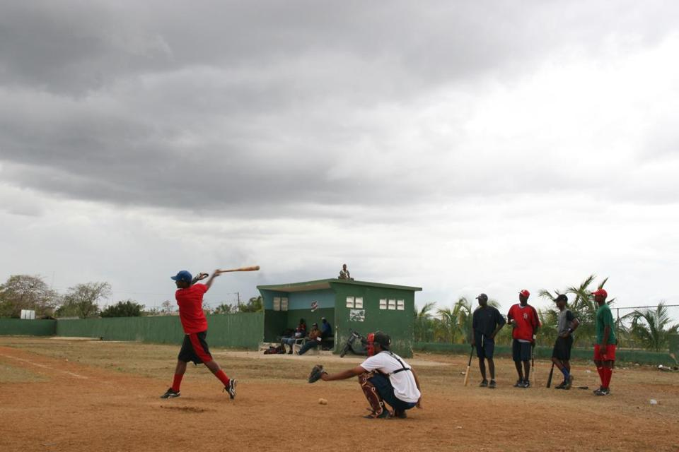 Youngsters in the Dominican Republic vie for the attention of Major League Baseball and team scouts, behind whom stand the prospect of fame and wealth.