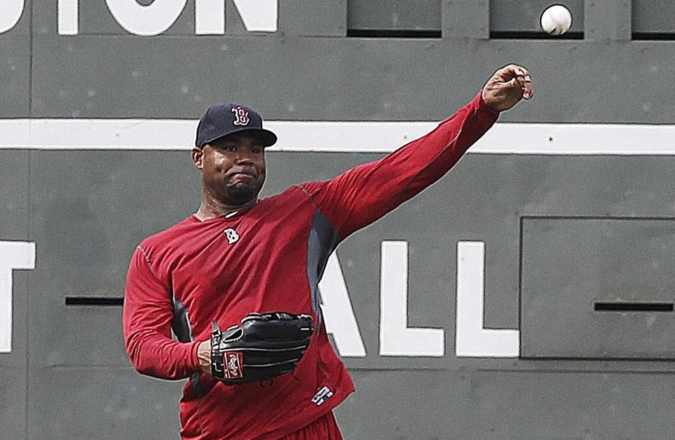 Carl Crawford completed drills in the outfield before the second game of a doubleheader with the New York Yankees at Fenway Park July 7.