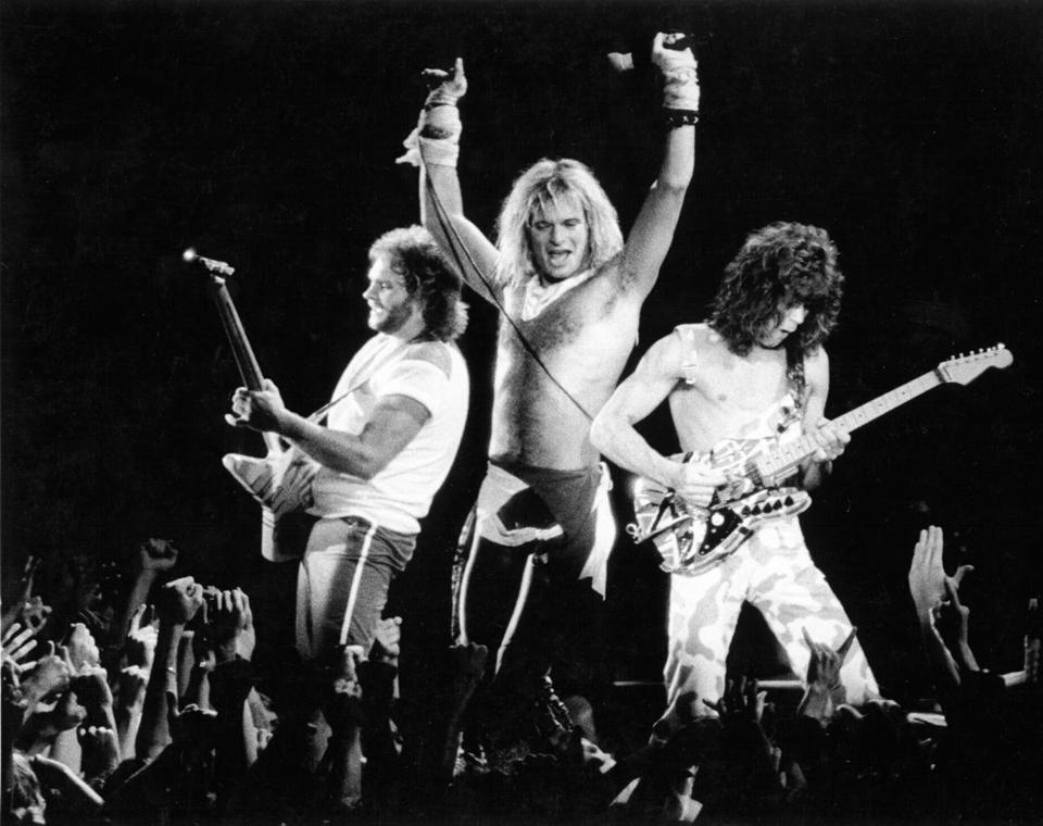 Van Halen performs. From left, Michael Anthony, David Lee Roth, and Eddie Van Halen.
