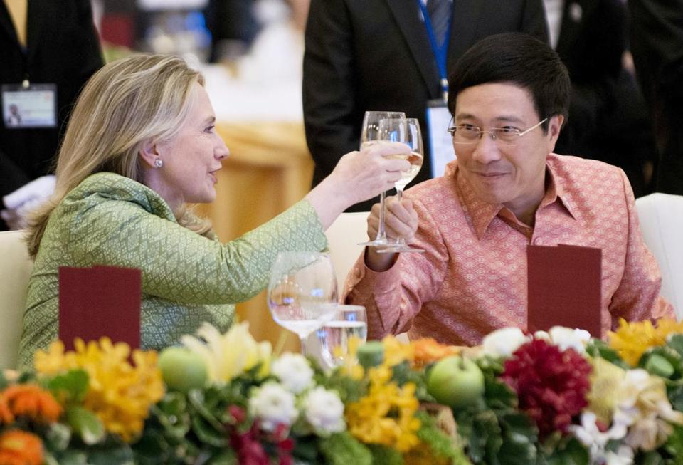 Secretary of State Hillary Clinton shared a toast with Pham Binh Minh, Vietnam's minister of foreign affairs, at the ASEAN Gala Dinner in Phnom Penh on Thursday. During the meetings, Clinton warned that more confrontations over the South China Sea would occur if there was no cooperation.
