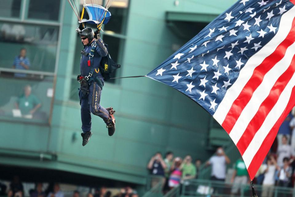 Petty Officer First Class Thomas Kinn parachuted into Fenway Park in early July.