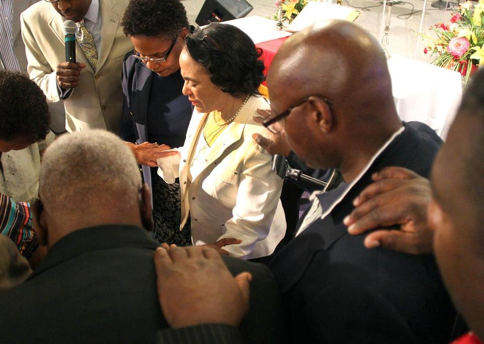 At a rally at Bethel AME Church in Jamaica Plain, ministers said a prayer for embattled Superintendent Carol Johnson (in white suit).