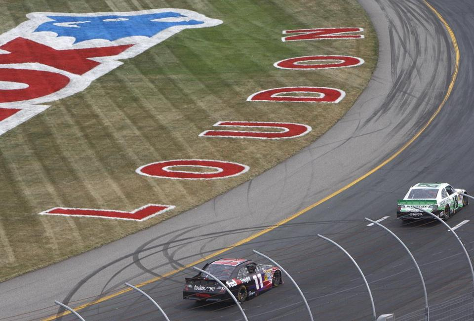 Denny Hamlin (11) is on the heels of Kyle Busch. Hamlin led a race-high 150 laps Sunday in Loudon, N.H.