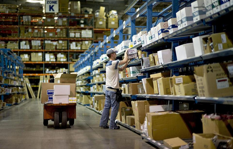 A worker stocked shelves at the J.C. Whitney distribution center in La Salle, Ill., in June.