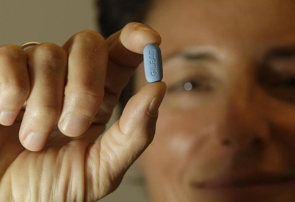 Dr. Lisa Sterman held up a Truvada pill at her office in San Francisco. The pill, already used to treat people with HIV, also helps prevent the virus from infecting healthy people.