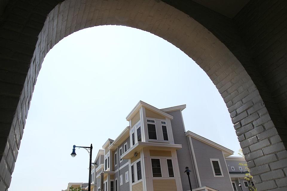 The new Old Colony buildings are framed by an archway in the old buildings in 2012.