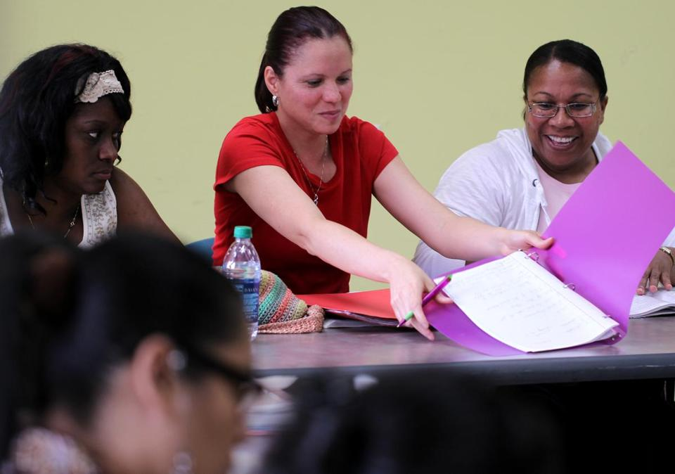 Brenda Delgado (center) participated in a class at Urban College, which may have to cancel its fall courses.