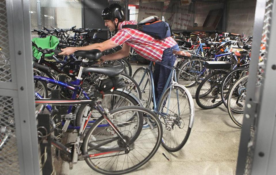 Software engineer Mike Reed stored his bicycle in a secure cage inside a Kendall Square parking garage.