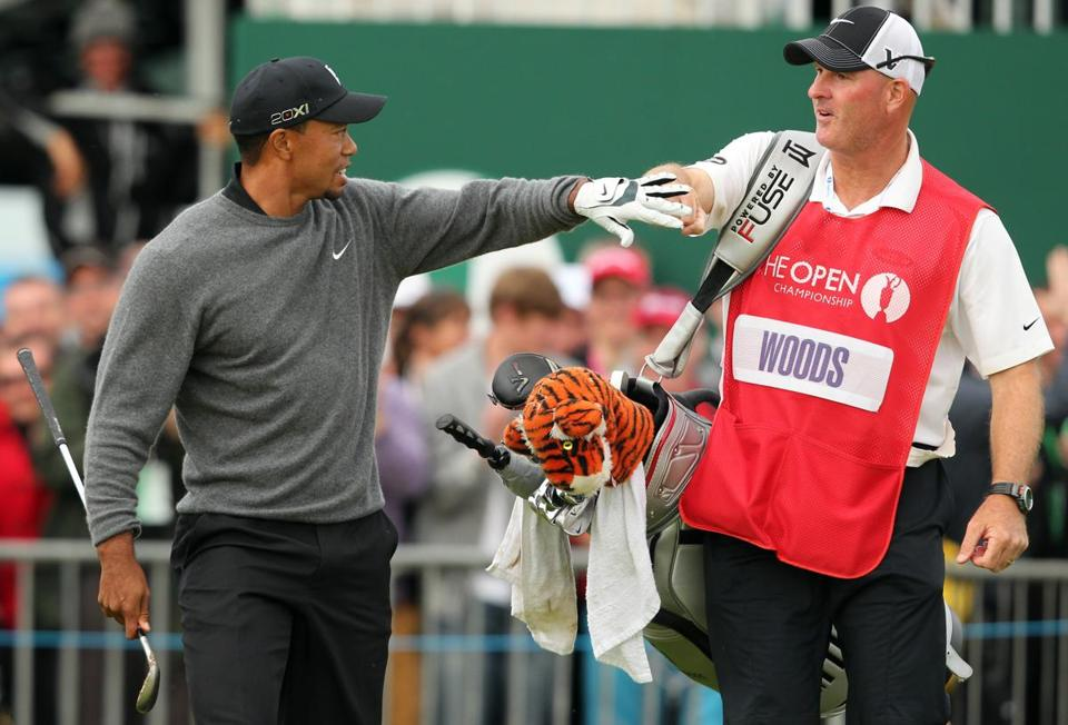 Tiger Woods celebrated with his caddie Joe Lacava after chipping in a bunker shot on No. 18.