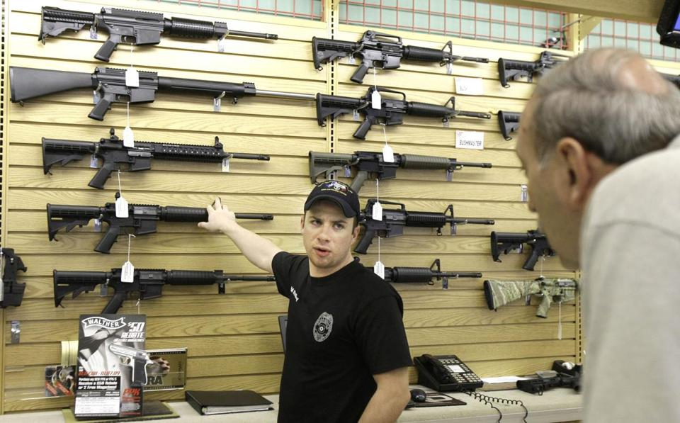 An employee helps a customer at a gun shop in Fort Worth, Texas.