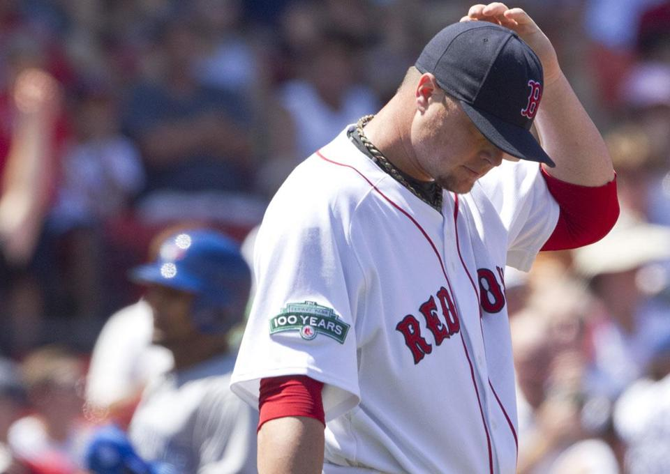 Jon Lester tries to figure it out as J.P. Arencibia rounds third base after his three-run homer in the second.