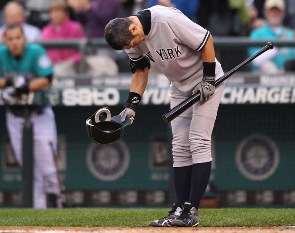Ichiro Suzuki, who played for the Mariners since 2001, donned a new uniform as a member of the Yankees and took a bow as the fans at Safeco Field showed their appreciation.