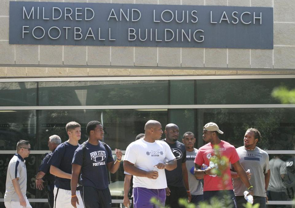 Penn State players leave the Lasch Football Building following a team meeting Monday.