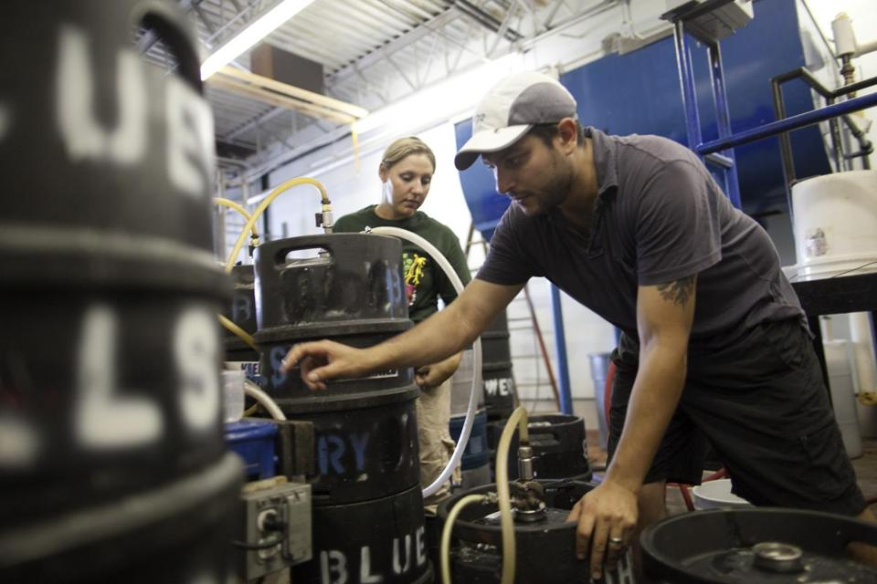 Eric Bachli, 32, and 25-year-old Vilija Bizinkauskas, interns at Blue Hills Brewery in Canton, filled one of 32 kegs full of the signature summer beer Watermelon Wheat.