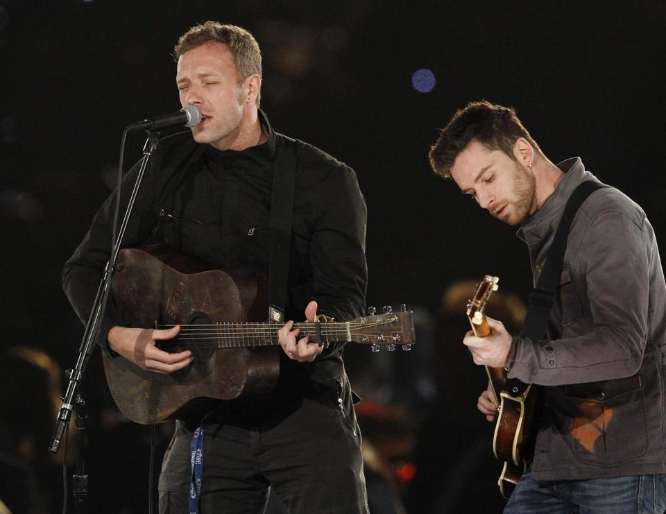 Chris Martin and Guy Berryman of Coldplay in Los Angeles in February. Stage tricks the group offered Sunday night, including remote-activated flashing wristbands for the audience, didn't detract from the music.